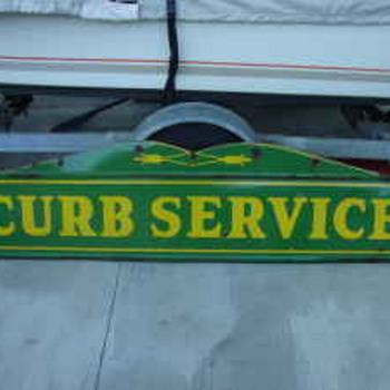 1932 Pharmacy and Curb service sign