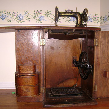 New Home Sewing Machine in Cabinet, circa late 1800s - Sewing
