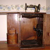 New Home Sewing Machine in Cabinet, circa late 1800s