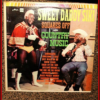 SWEET DADDY SIKI - PROFESSIONAL WRESTLER & Singer - Records
