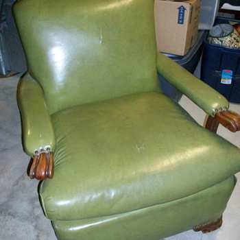 Green Naugahyde recliner chair