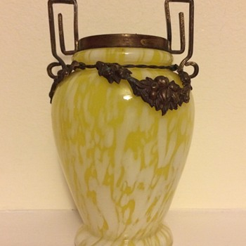 Brass mount on a yellow spatter vase