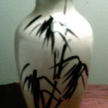 Yellow vase with  black design
