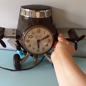 Prop plane Sessions clock