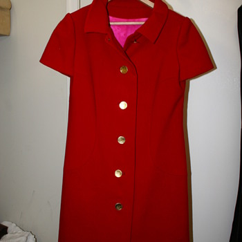 Red dress coat with gold buttons and iridescent lining