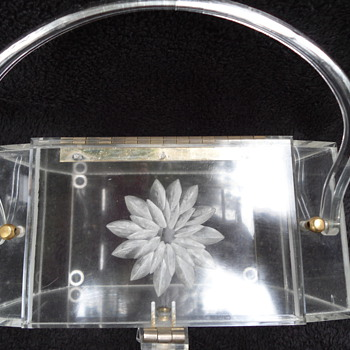 vintage clear lucite handbag with handles and floral carving