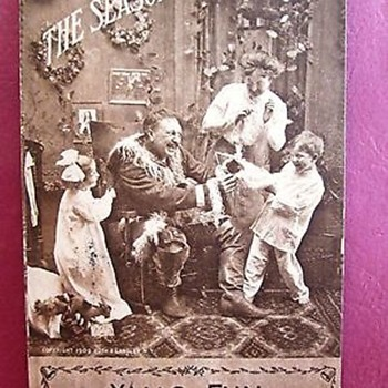 1909 PHOTO POSTCARD--CHRISTMAS,  SEPIA, SANTA LOSES BEARD TO DELIGHTED CHILDREN!