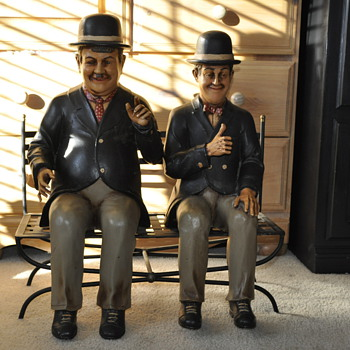 Laurel and Hardy seating on the bench. Large decorative display.