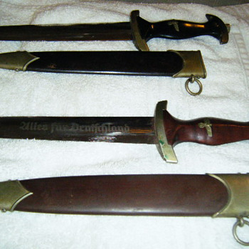 2 daggers 1 black and 1 brown/red - Military and Wartime