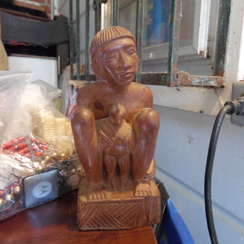 Old Wood Man Holding a Large Bird Native American - Visual Art