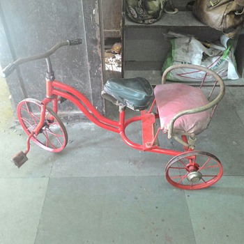 old tricycle with baby seat