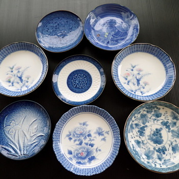 Small Asian porcelain plates.