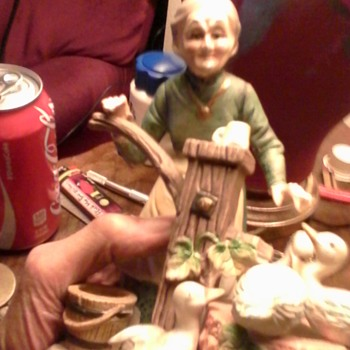 Ceramic, grandma pumping for four ducks. 5inches