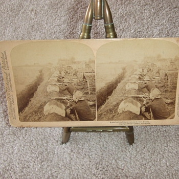 Stereoview of Cavalrymen fighting from trenches