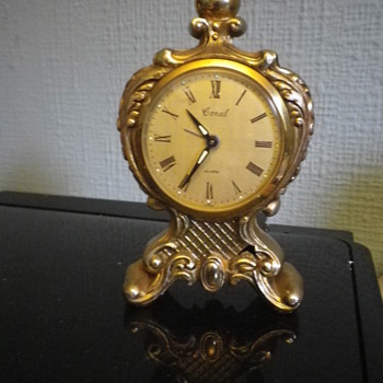 Coral Alarm clock possibly 1950's in the style of a Franch 18th Century style carriage clock.