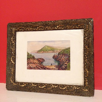 A lovely little painting of the Coast. I can't work out the Signature?