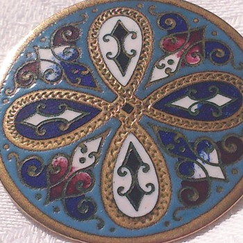 Beautiful enamel brooch late 19th, the enamel looks like french champleve but the decoration looks scottish. Origin unknown.
