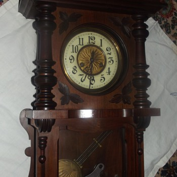 German 8 Day Clock with Porcelain Numbered Face
