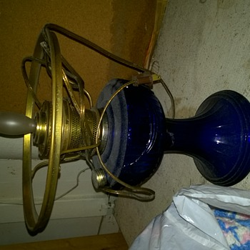 Need help identifying blue glass lamp