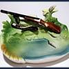 Couple old Ceramic ASHTRAY -- ( Gun ) and ( Bird ) Styles