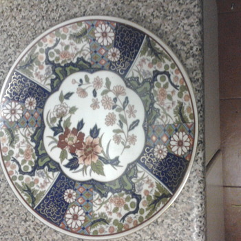 Beautiful hand painted Asian plate of flowers