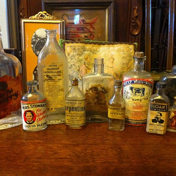 Antique glass bottles with lables - Bottles
