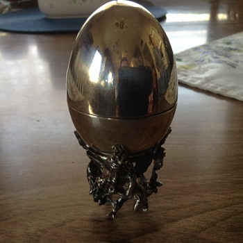 Pure silver egg on cherub stand