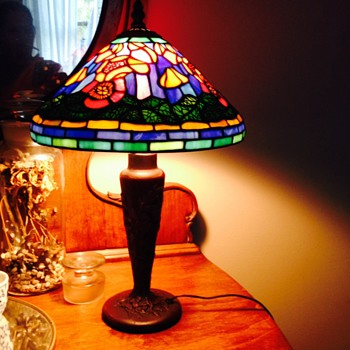 Tiffany Style table lamp, leaded glass shade. Poppy lamp shade with metal overlay. Base is heavy and wired for electricity.