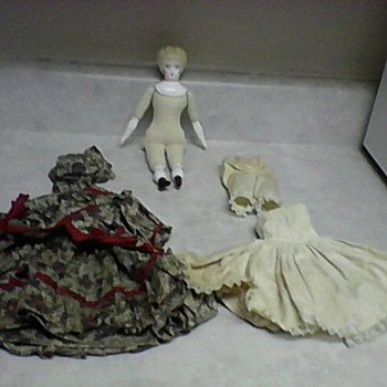 BLONDE CHINA HEAD DOLL AND CLOTHS