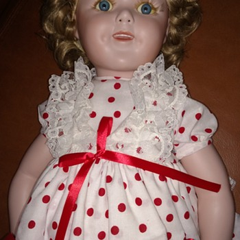 Help me find out about this SHIRLEY TEMPLE PORCELAIN DOLL - Dolls