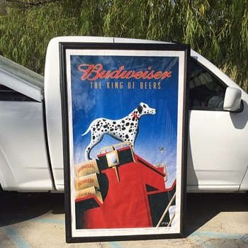 Large Budweiser poster in frame.