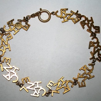 "Chanel ""C-H-A-N-E-L"" Gold-Tone Necklace"