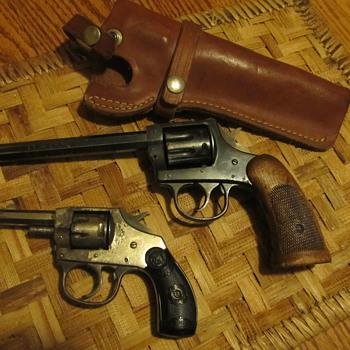 H&R wallhanger pistols.