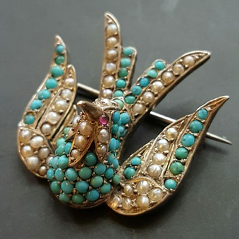 Victorian humming bird brooch.