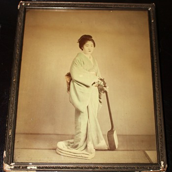 Old Photo of a Geisha with a Samishen
