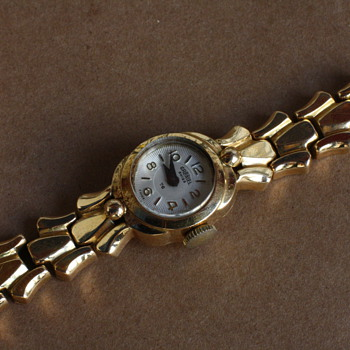 18 karat gold woman's watches