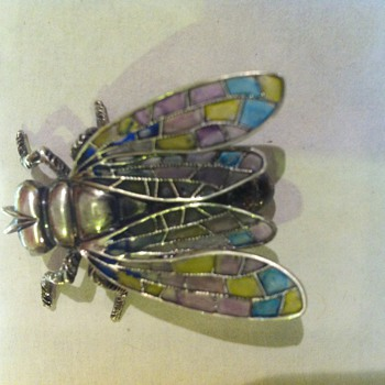Plique a jour enamel created on a Beau Sterling fly pin.