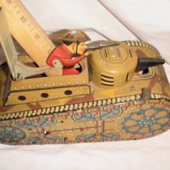Tank metal old toy with head of soldier with gun
