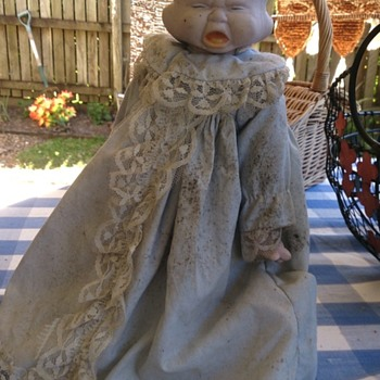 three faced porcelain doll