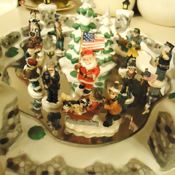 Christmas Ice Skating, porcelain with shiny metal for ice and looks like hand painted figures?