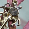 Can anyone help me identify this marking?  It is a stick pin of a half horse and half man shooting an arrow.