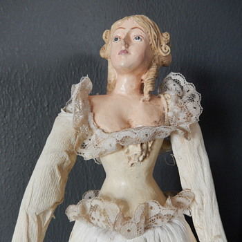 old ballerina doll with male face on bust