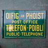 Post Office sign for public telephone.