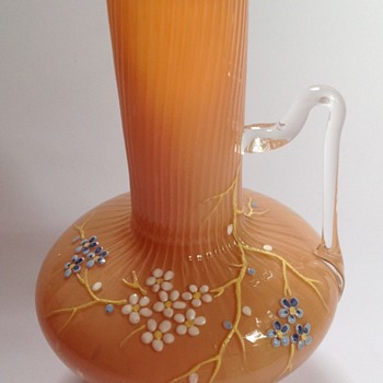 Victorian pink cased glass vase with applied handle & floral decoration