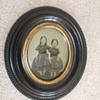 Thermoplastic wall frame with ambrotype of two girls