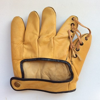 Old leather Goldsmith baseball mitt.