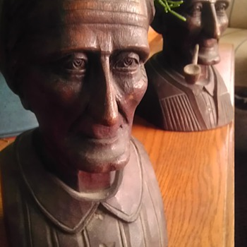 Wood carving of elderly couple