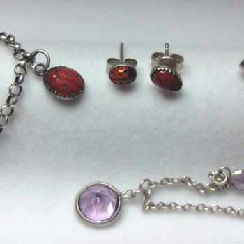Colllection of silver (enameled) children's jewelry