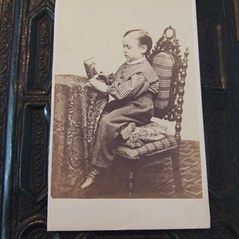 CDV of a boy looking at a portrait CDV of a woman