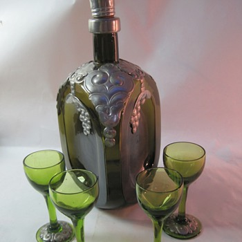 Pinched glass decanter with pewter overlay